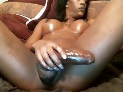 Sexy Ebony Goddess Strokes Her Massive Cock
