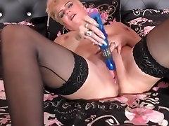 Mature blonde in stockings masturbation