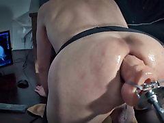 Big dildo machine fucks her tight ass