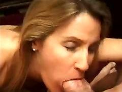 Mature woman sucks huge cock