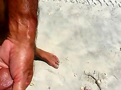 2 big cocks at the beach with cumshot