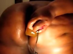 Black BBW toys with her ass