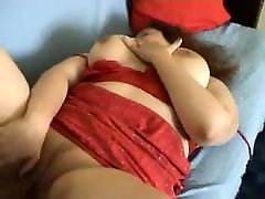 Sweet and appetizing white amateur BBW chick on the couch
