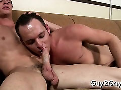 Straight lad enjoys homo sucking his hard jock and balls