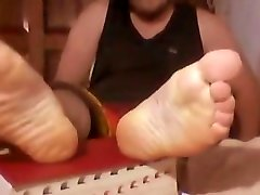 Straight bear showing his feet on webcam