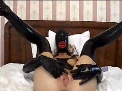 hooded rubber latex slave girl dildo play