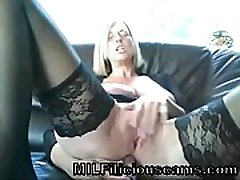 Hot MILF on cam wearing black stockings and lingerie - MILFiliciouscams.com