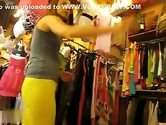 Thongs peeking out of her yellow pants