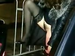 Asian hairy babe in stockings and dress pees next to car 1