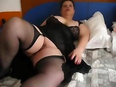 V in black stockings is stripping