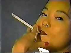 Colight Kim Smoking A Shermans 164s Cigarette With A Holder Clp