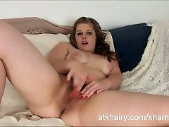 Chubby and hairy girl Natalie fingers her wet pussy