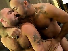 Gay bear rides hard studs cock