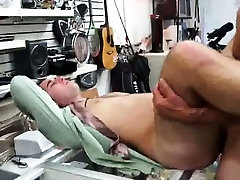 Amateur hunk getting double teamed at a pawn shop