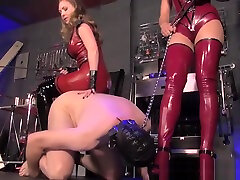 Femdoms force submissive to suck cock