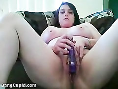 Chubby chick with big booby toying her pussy