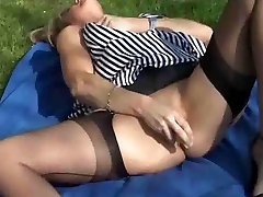 Mature blonde in stockings