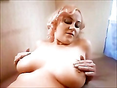 Sexy Rita shows and massages her big tits