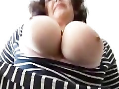 Big tits mature showing upskirt with no panties as she teases