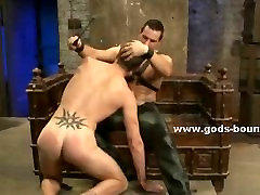 Gay slave wrapped and bound in cuffs filled with bondage toys mas