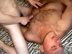 Daddy bear fucks a boy