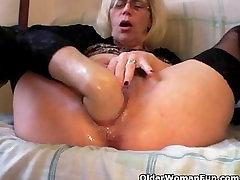 Blonde mature fisting herself