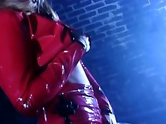 Pretty blonde masturbates in red latex and shiny stockings with a dildo
