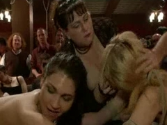 Two bound babes in mirror image fuck in public party