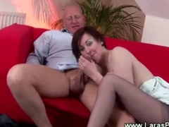 Mature lady in stockings does handjob