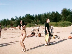 Lovely teens bare their bodies at a nudist beach