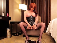 Redhead shemale toying her ass before anal