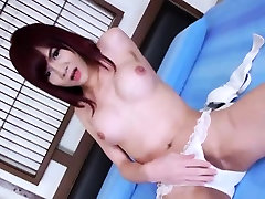 Asian transsexual Ping wanks her hard prick in a bedroom