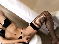 Spex ladyboy toying her ass with dildo