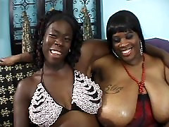 Two black fat milfs with gigantic racks lick pussy and fuck with sex toys