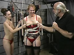Perky tit young brunette domme loves to restrain and torture thick older slave
