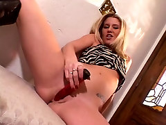 Blonde with small tits shows her pussy and plays with dildo