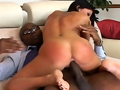 Stunning raven haired MILF rides on a black cock