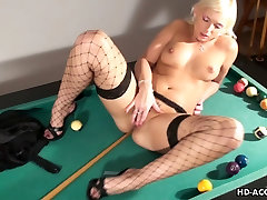 Busty mature chick plays with her shaved cunt
