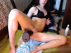 crazy slut takes on a big black dildo