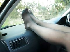 mature legs in stockings out in the car